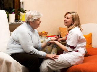 medical personnel and elderly patient talking