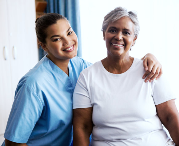 a medical personnel and an elderly women in a picture