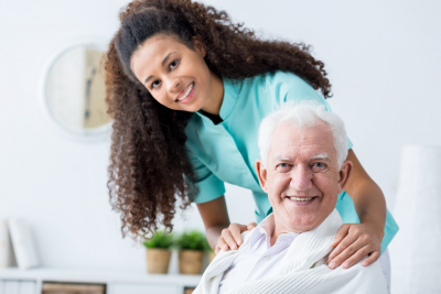 female caregiver and her old man patient