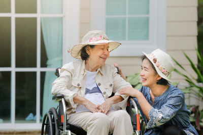 asian old woman and her care taker